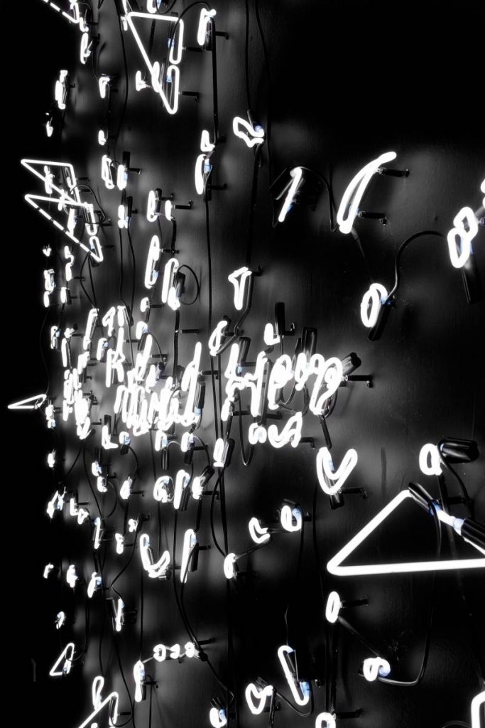 Tavares Strachan, We Belong Here, 2012, Fragmented neon on black painted wall, 280x300x20 cm