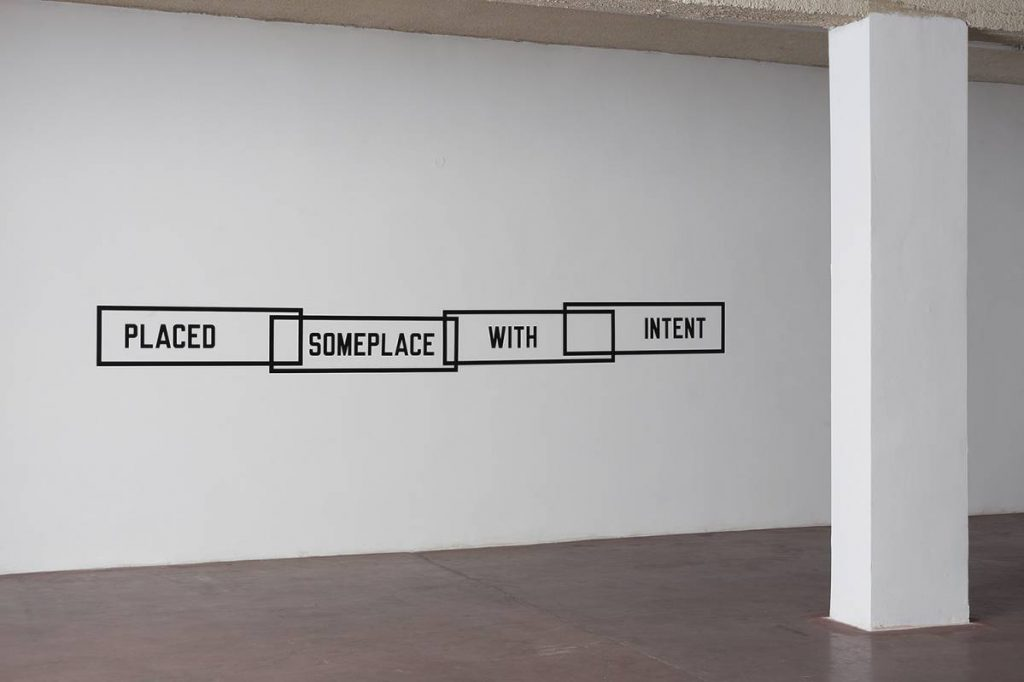 Lawrence Weiner, Placed Someplace with Intent, 2014, vinyl print, variable dimensions, unique