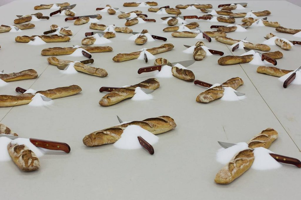 Mircea Cantor, Stranieri, 2007/2016, 49 baguettes, 49 knives, salt, wood table, 520 x 360 x 80 cm, unique (detail)