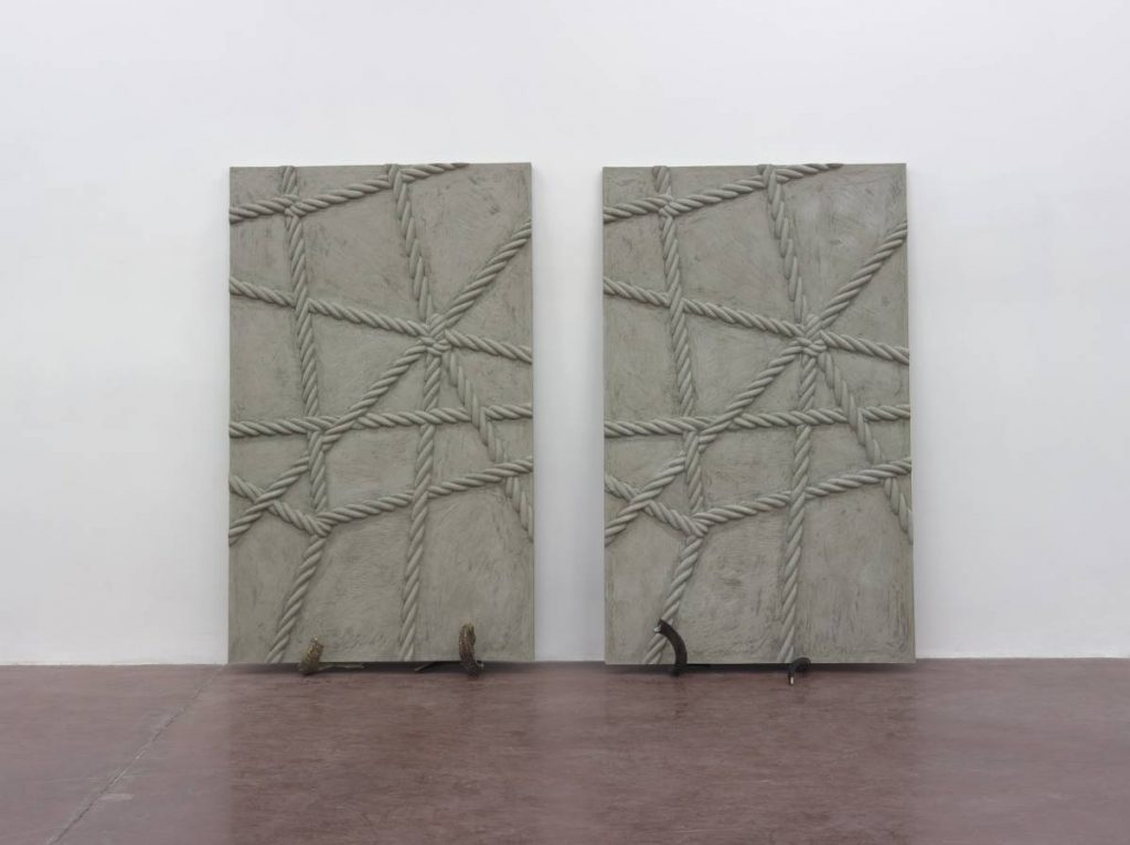 Mircea Cantor, Supposing I could hear that sound. Now, 2015, concrete, 2 shofars, concrete walls 200 x 123 x 6 cm, unique