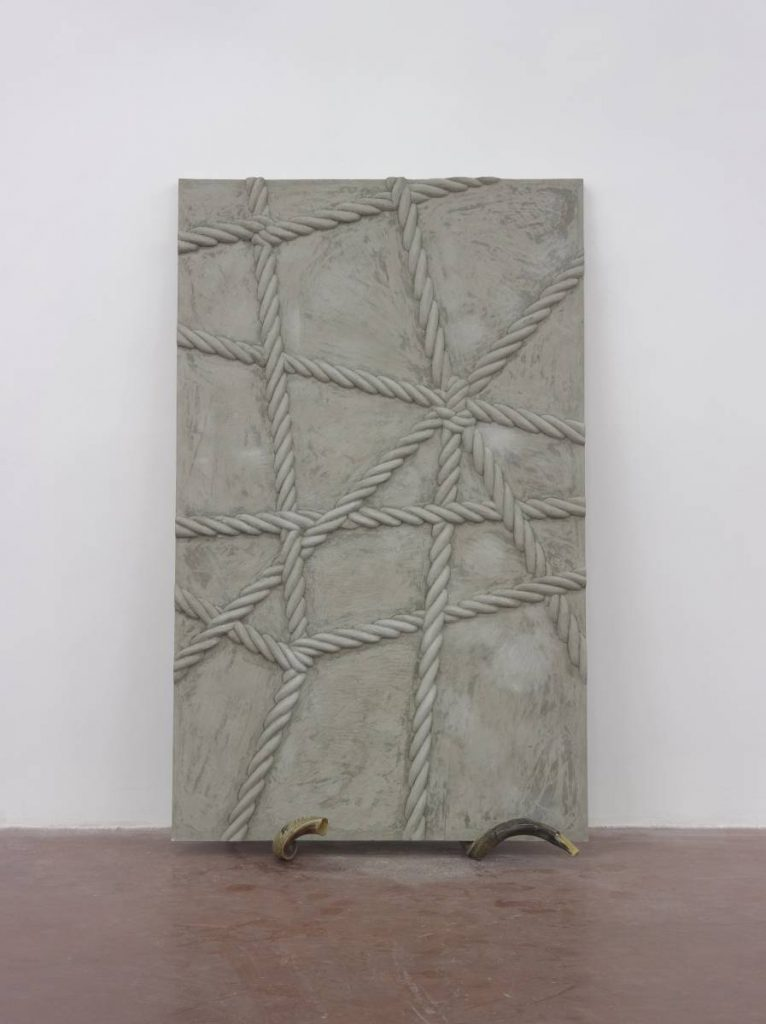 Mircea Cantor, Supposing I could hear that sound. Now, 2015, concrete, 2 shofars, concrete walls 200x123x6 cm, unique
