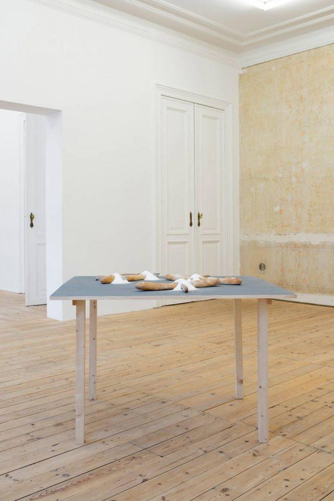 Mircea Cantor, Stranieri, 2007, 3 baguettes, 4 knives, table, 100 x 100 x 80 cm, Unique