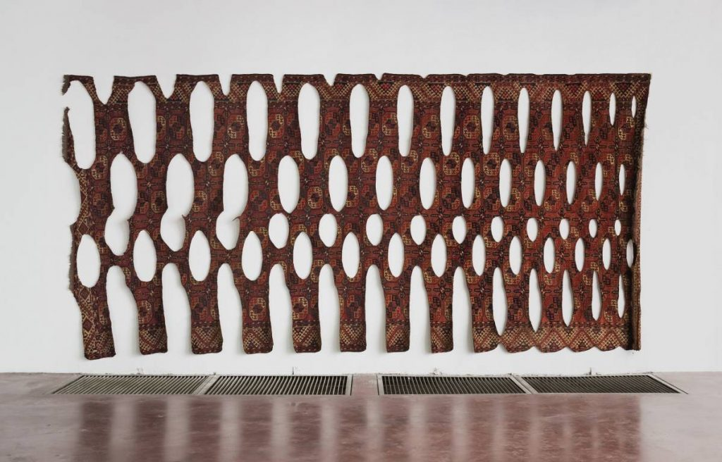 Ariel Schlesinger, Untitled, 2014, burnt carpet, 245 x 500 cm, unique