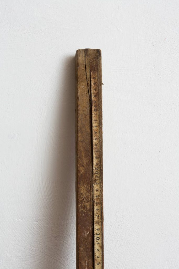 Ariel Schlesinger, Something With Numbers (detail), 2013, wood, measuring tape, 174 x 4.5 x 3 cm