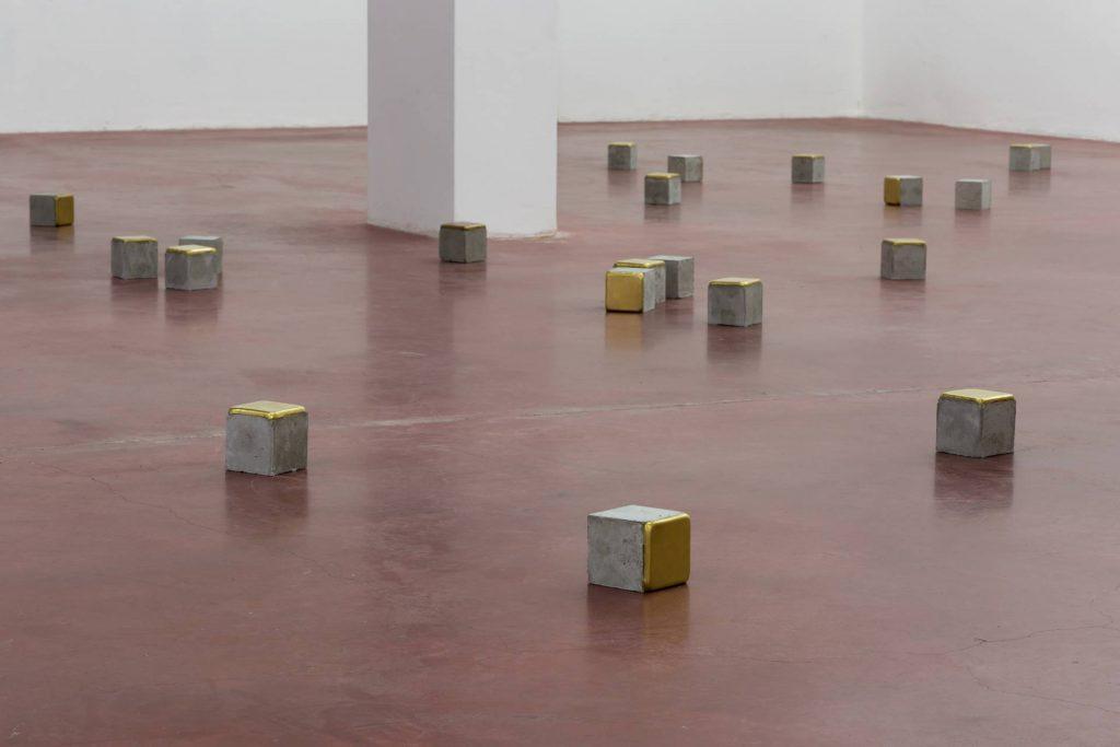 Ariel Schlesinger, Stolpersteine - 21 pieces, 2014, cement, brass, 10 x 10 x 10 cm each