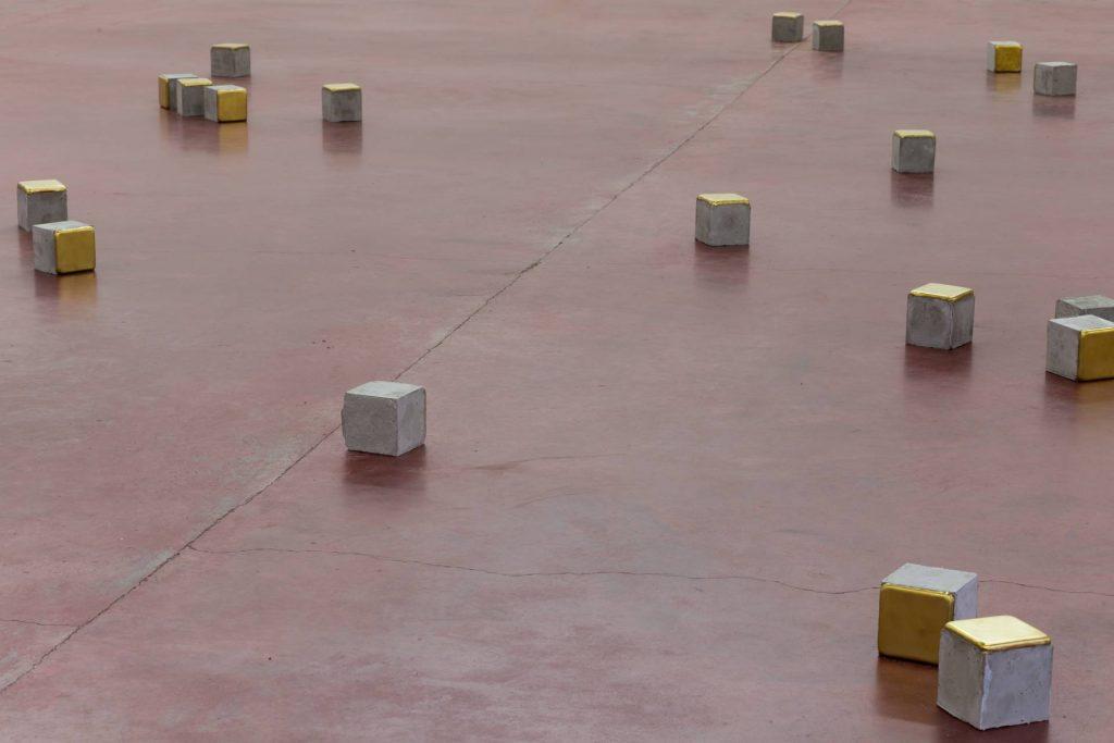 Ariel Schlesinger, Stolpersteine - 19 pieces, 2014, cement, brass, 10 x 10 x 10 cm each