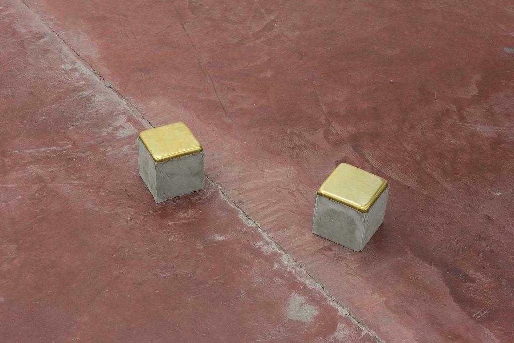 Ariel Schlesinger, Stolpersteine - 2 pieces, 2014, cement, brass, 10 x 10 x 10 cm each