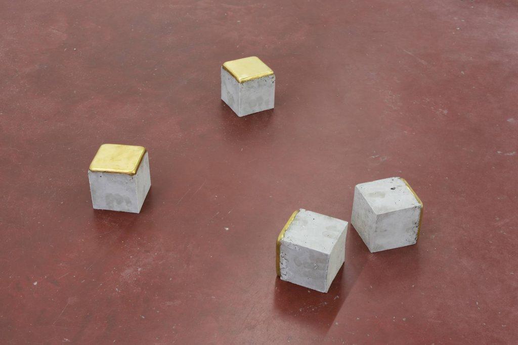 Ariel Schlesinger, Stolpersteine - 4 pieces, 2014, cement, brass, 10 x 10 x 10 cm each