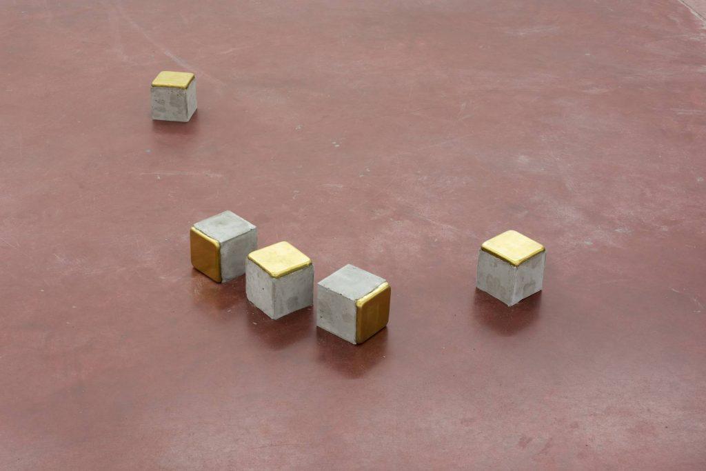 Ariel Schlesinger, Stolpersteine - 5 pieces, 2014, cement, brass, 10 x 10 x 10 cm each