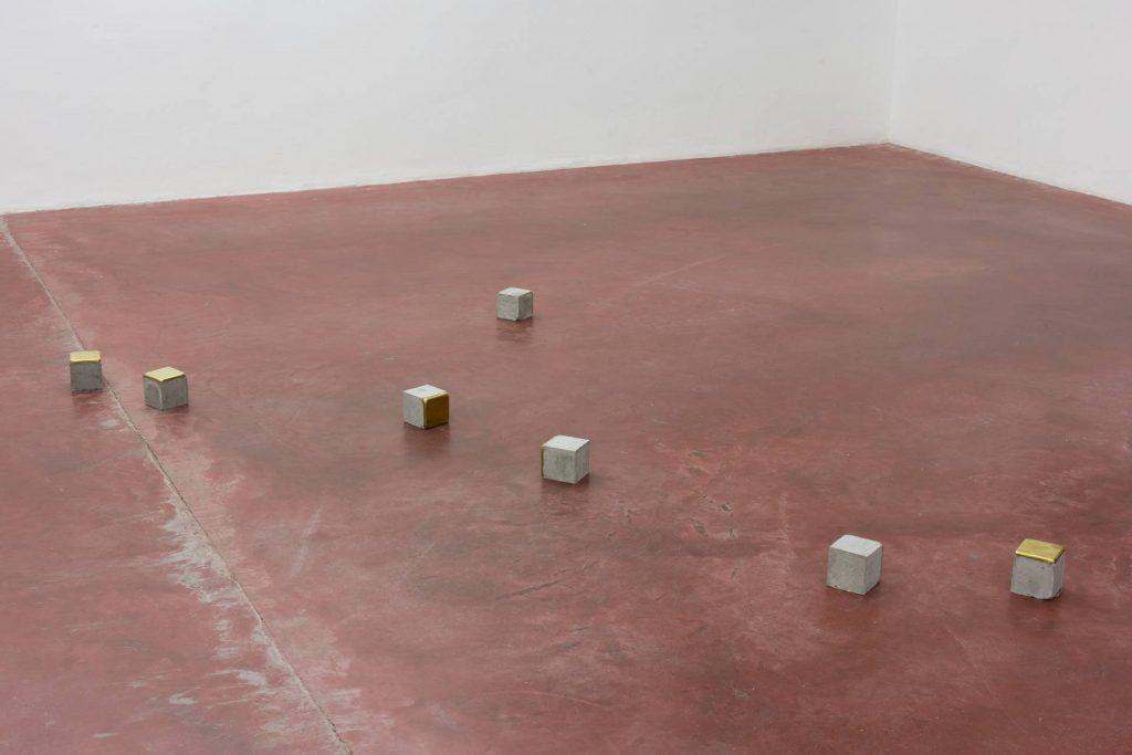 Ariel Schlesinger, Stolpersteine - 7 pieces, 2014, cement, brass, 10 x 10 x 10 cm each