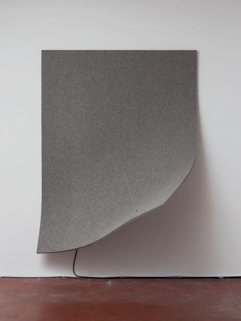 Naama Tsabar, Work On Felt (Variation 13), Grey, 2016, Carbon fiber, epoxy, wood, felt, microphone, guitar amplifier, 179.5x137.5x93cm, Unique