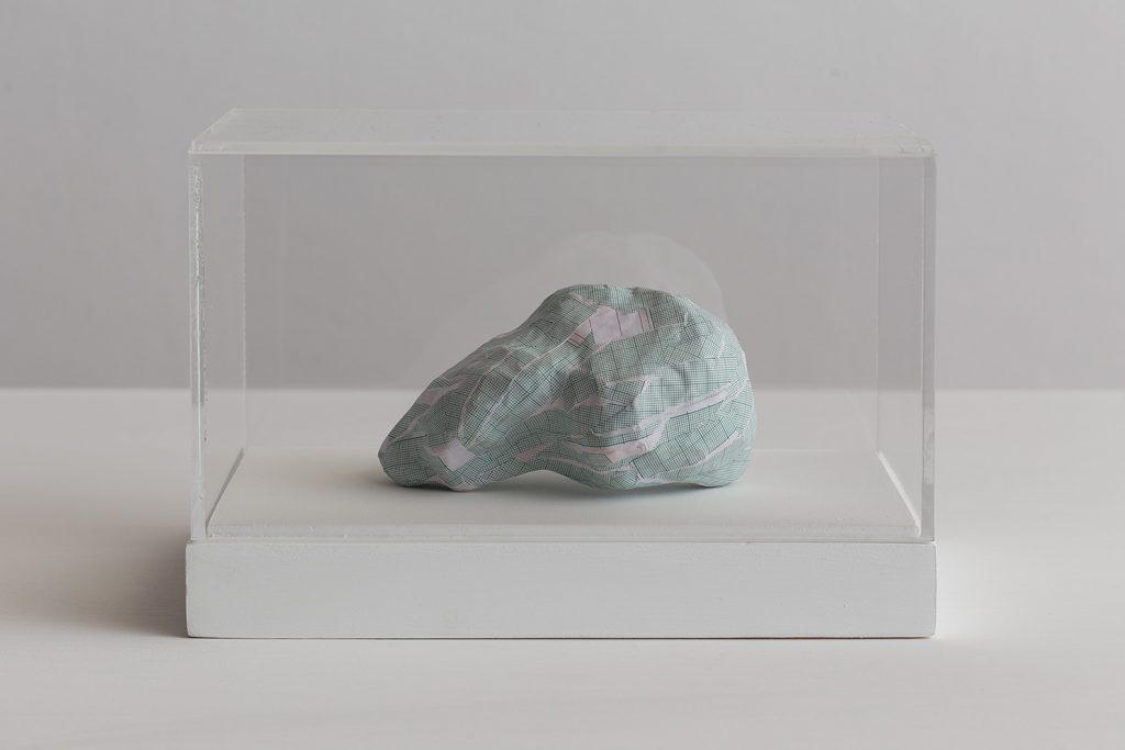 Shilpa Gupta, Untitled VI, 2016, graph paper in plexiglass vitrine, 20 x 29 x 17 cm, unique