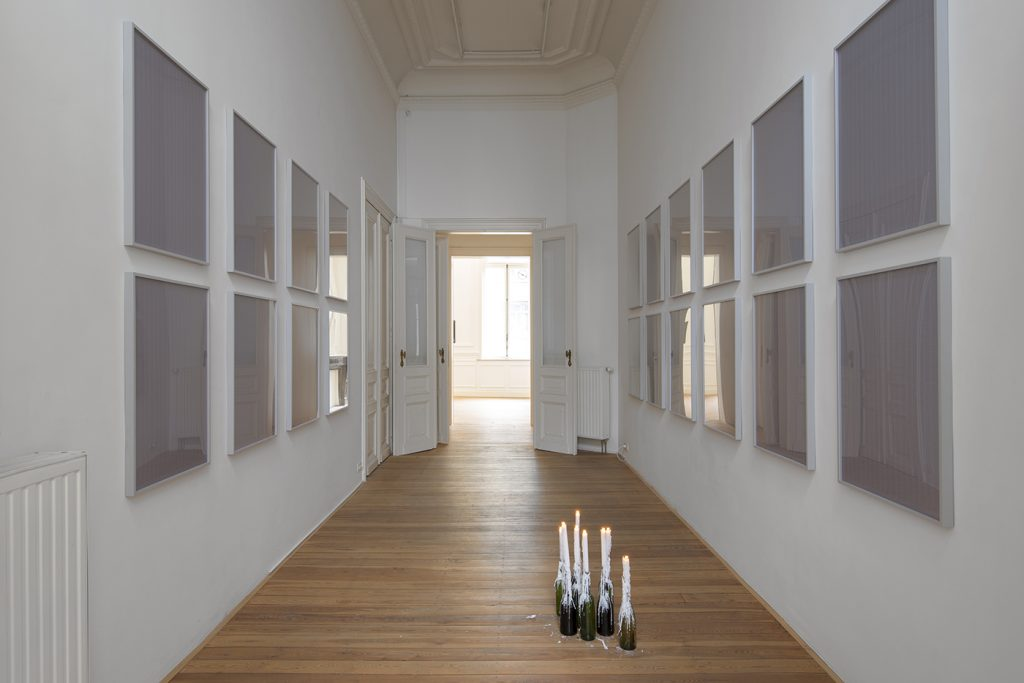 Jonathan Monk, All the possible ways of lighting eight candles, 2012, 20 framed prints, wine bottles, candles, 61.3 x 85.7 cm (each frame), unique