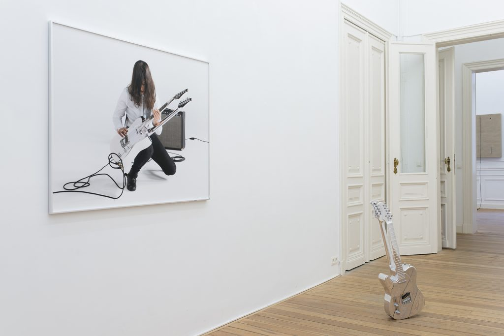 Naama Tsabar, Untitled #7 (from the Double Face Museum Series), 2016, dye sublimation print, chrome frame and chrome guitar, 104 x 130 cm (frame), edition of 3 + 1 AP, 86.4 x 29.7 x 12.7 cm (guitar), unique with a print