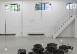 En Rang, 1992, 12 typewriters, 4 light bulbs, unique